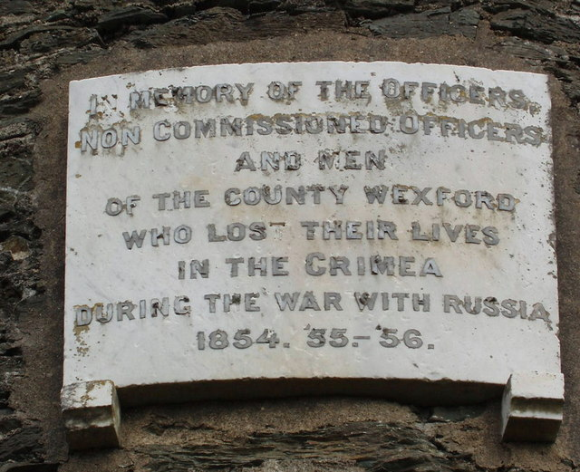 Plaque on round tower memorial, Irish National Heritage Park