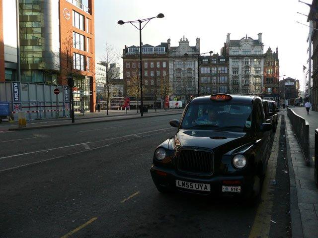 Taxis on Portland Street near the corner with Aytoun Street
