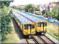 SD3214 : Merseyrail trains passing at Hillside by Stephen Craven