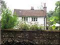 SP8908 : A flint wall hides Hengrove Cottage beside the Ridgeway, Chivery by Chris Reynolds