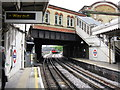 Beyond the station buildings and overbridge a Hammersmith & City line train is starting to descend the underpass which will take it to the north side of the main lines into Paddington station.