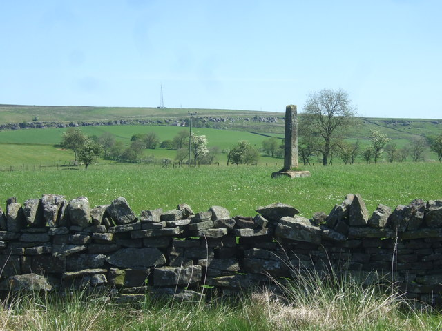 Ancient cross in a field