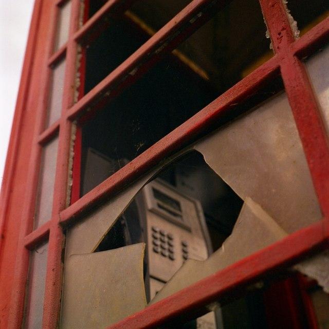 Broken phone box on Main Drove
