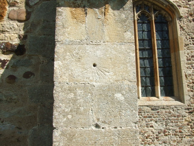 Scratch dial on buttress of Great Paxton church