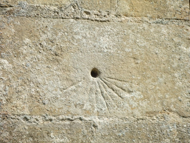 Close up of scratch dial on Great Paxton church