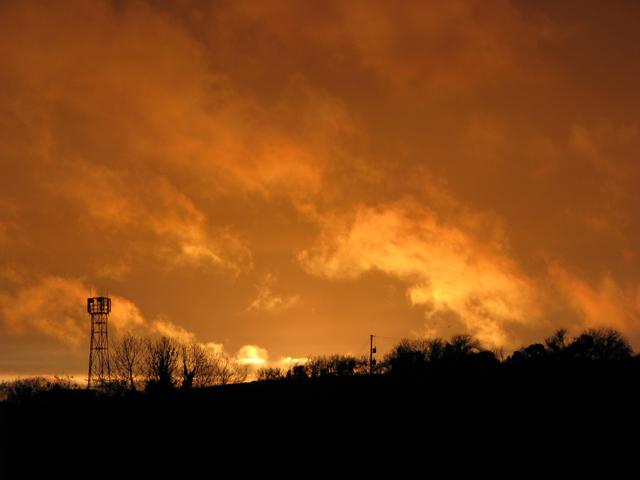 Fiery sunset over 'Orange' tower