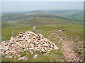 NT9221 : Cairn on the eastern flank of Cheviot by Stephen Craven