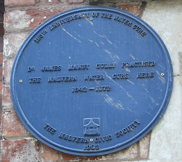 The plaque was placed on the Tudor Hotel in 1992 by the Malvern Civic Society to celebrate 150 years of the Malvern