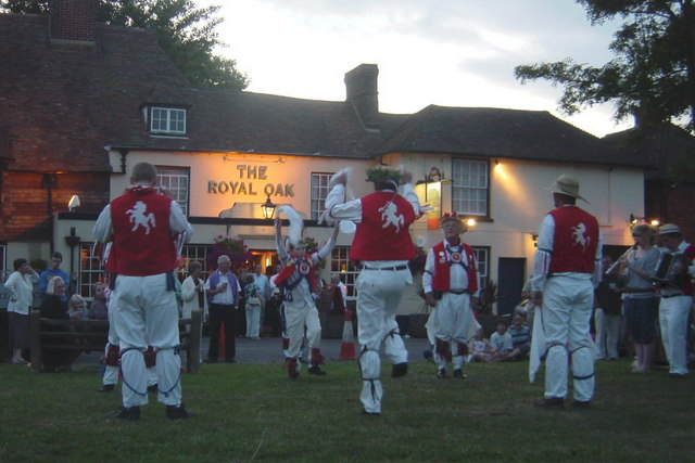 Morris Men on Green in front of Pub