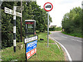 TL4107 : Phone box and signage, Roydon Hamlet by Stephen Craven