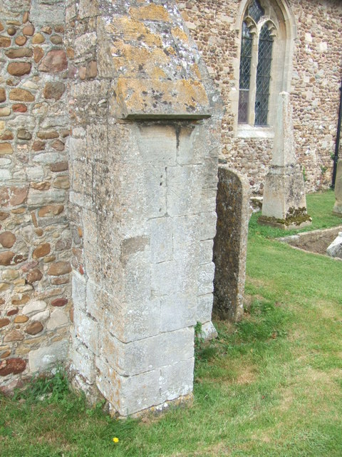 Mass dial on buttress of Holy Cross church