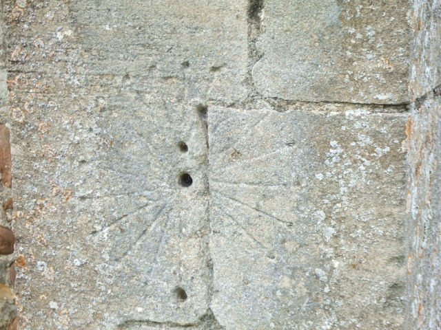 Mass dial on buttress of Holy Cross church (close up)