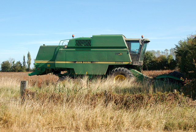Combine parked ready to harvest a field of beans