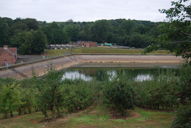 Pembury Reservoir & Waterworks seen beyond orchards
