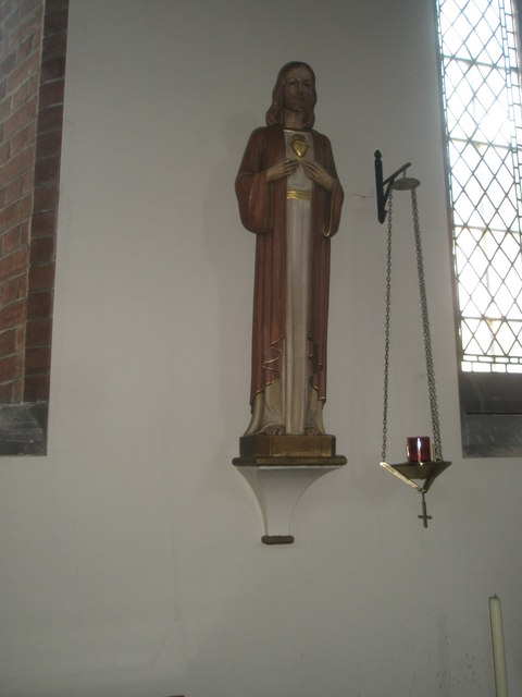 Statue on the north wall at St James, Milton