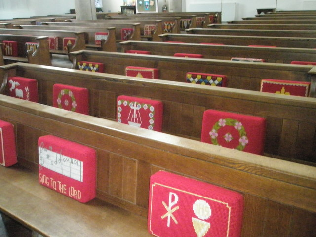 Kneelers and pews within St James, Milton