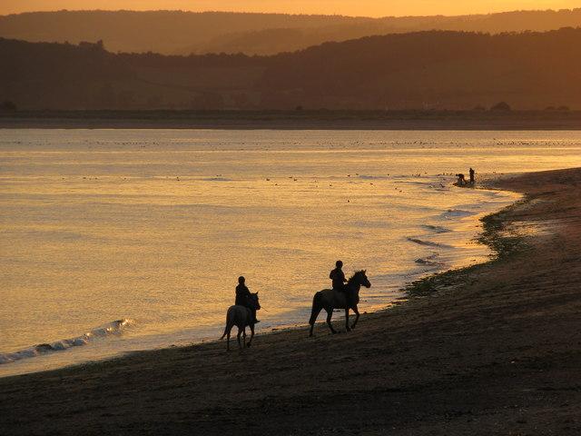 An evening ride along Exmouth beach