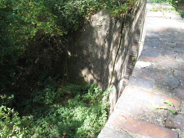 View from bridge parapet showing crack in support wall