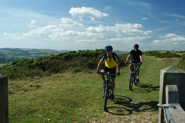 Cyclists on Nine Barrow Down, Dorset