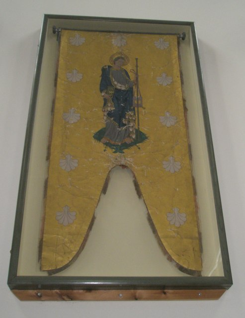 Old manorial banner on the west wall of St James, Milton
