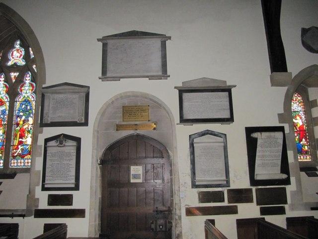 Memorials round the doorway