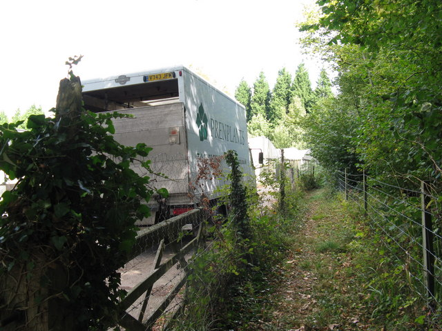 Delivery lorry beside footpath