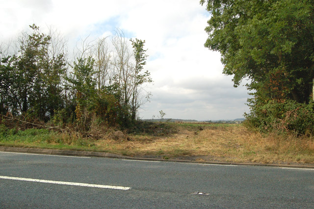 Ungated field entrance on west side of the A423 road