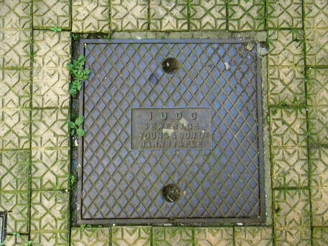 Inspection Cover bearing the legend: IUDC, Sewage, Young & Son Ltd, Barnstaple