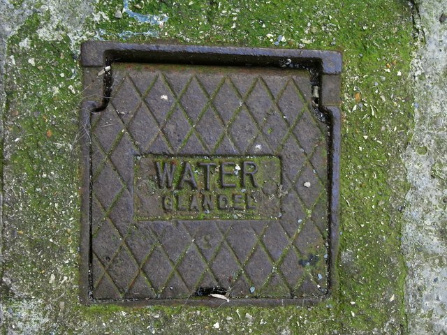 Water stop cock access cover bearing the name Glandel