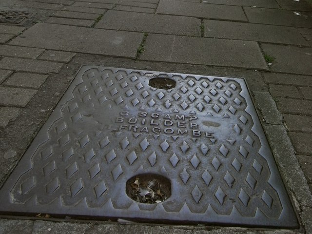 Inspection cover bearing the name G Scamp, Builder, Ilfracombe