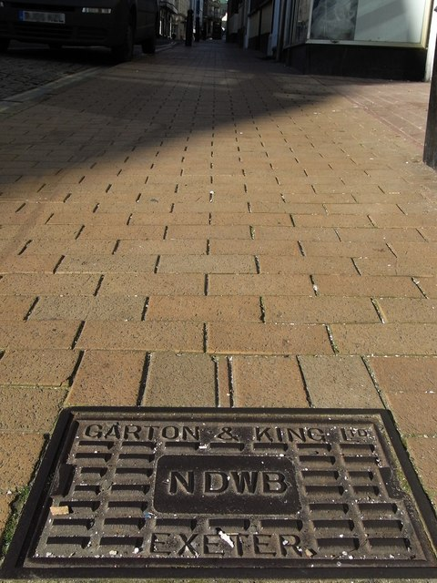 An inspection cover with the inscription Garton & King, Exeter & NDWB