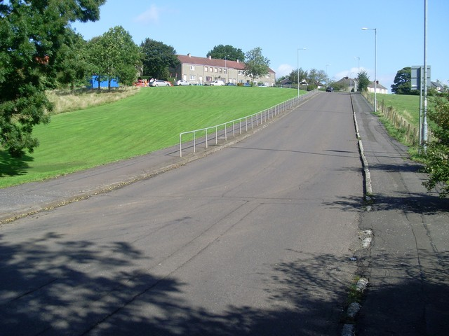 Uphill to houses by Langmuirhead Road