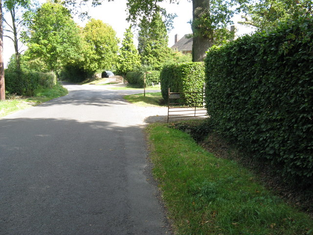 Footpath waymarker at entrance to Holmbush Manor Farm