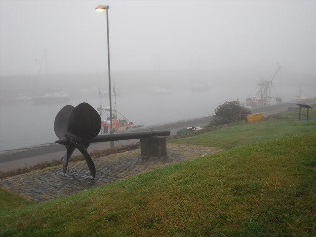 Screw in misty Dunbar harbour