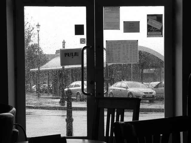 New public conveniences at the cattle market car park viewed through the rain from The Boston Tea Party