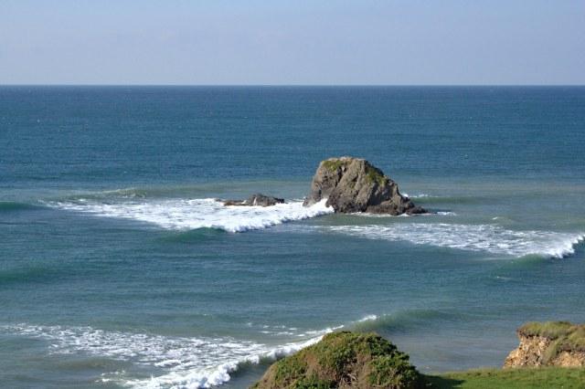 Waves Breaking Around The Black Rock