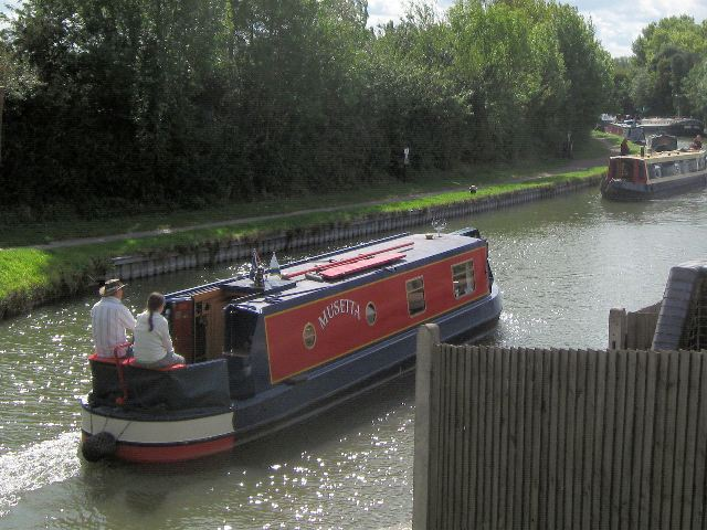 "Narrowboat ""Musetta"" approaching the Marsworth Junction  of the Grand Union Canal"