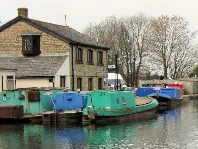 Another view of the Canal Waterway Office with  moored maintenance barges
