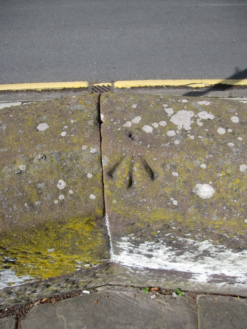 Rivet bench mark on the city walls