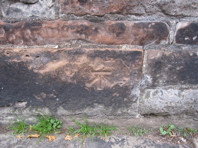 Bench mark below the city walls in Duke Street