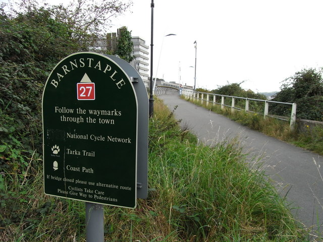The Tarka Trail, Coast Path and National Cycle Network approaching the footbridge over the river Yeo