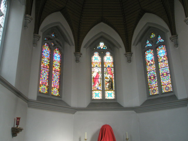 Stained glass windows above the altar at Sacred Heart RC Church, Fareham