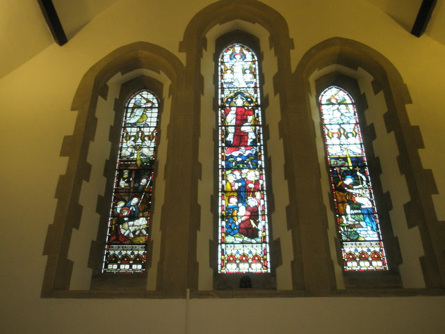 Stained glass windows on the west wall at St Barnabas, Swanmore