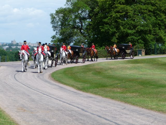 Queen's Carriage Procession, with castle backdrop enters Duke's Lane to pick up the Queen and take her to Royal Ascot.