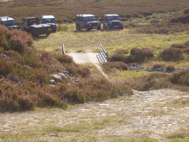 Landrovers of grouse shooting party