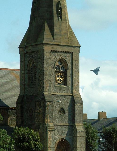 Vulcan bomber heading behind steeple