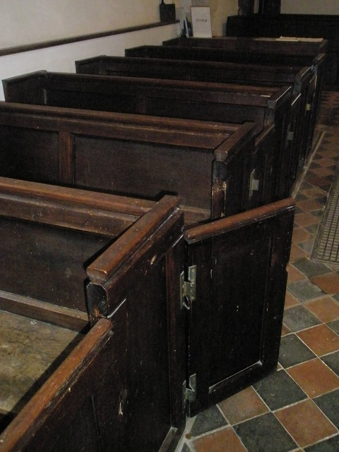Ancient pews within St Mary Magdalene, West Tisted