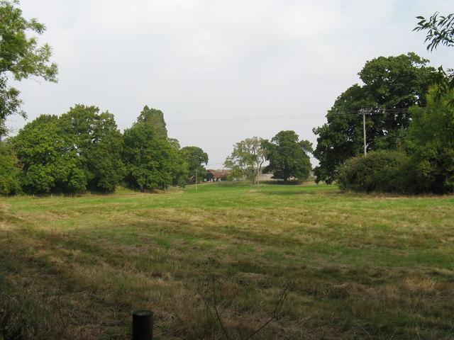 View across fields to Ewhurst Manor moat
