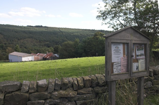 Noticeboard and Storey House Farm buildings