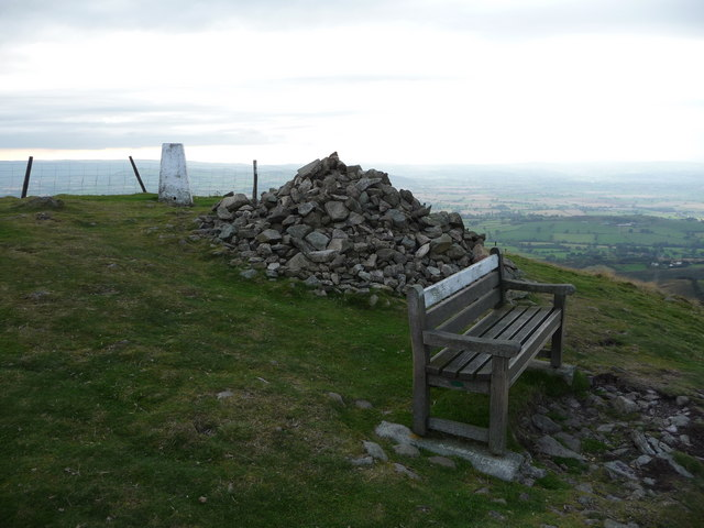 Corndon Hill trig point, bench and north cairn